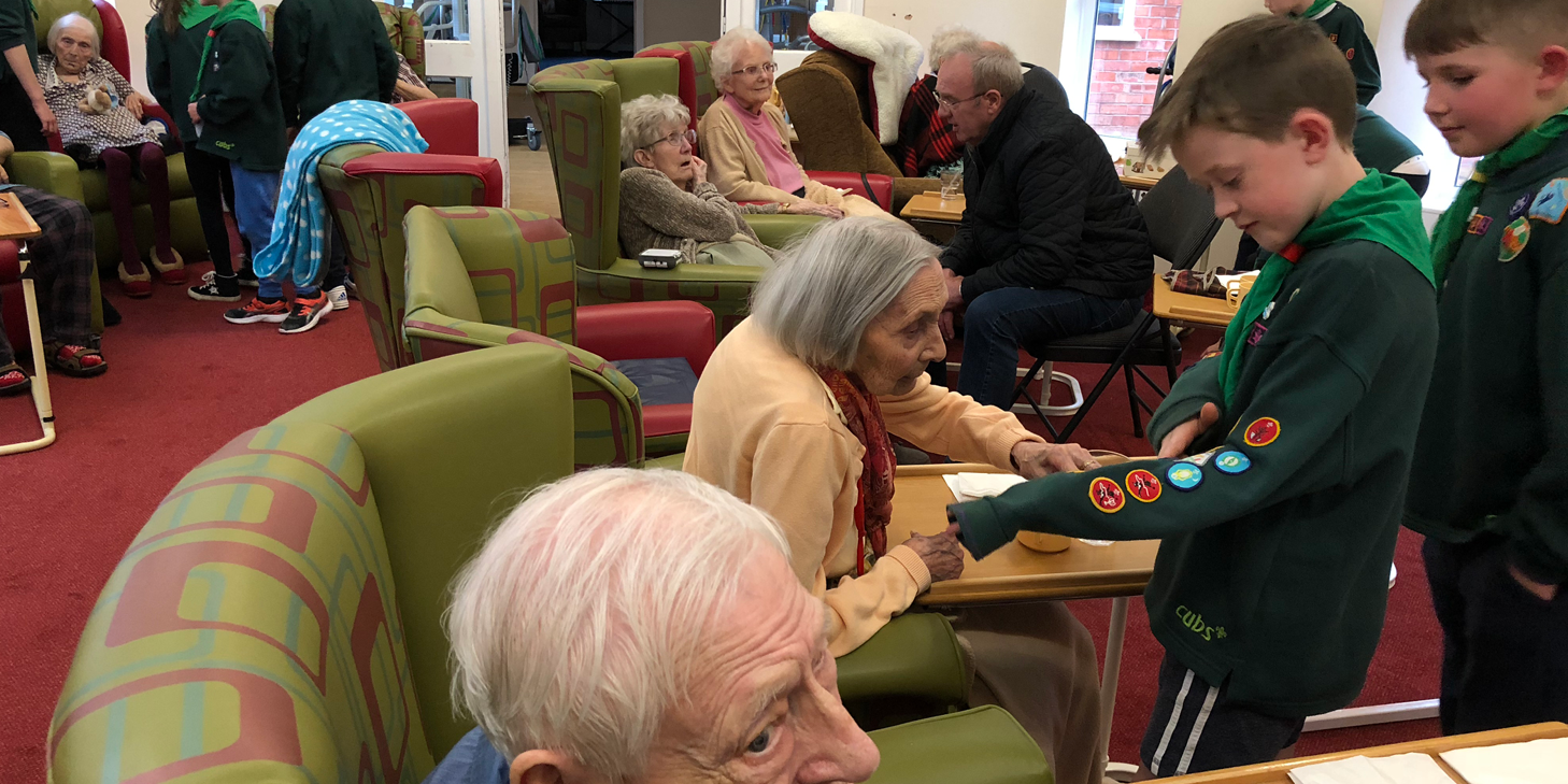 cubs visit care home